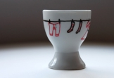 Porcelain egg cup with hand-drawn laundry line