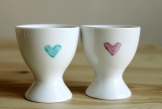 Illustrated egg cups with hearts on the back
