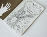 Moleskine cahier journal illustrating lyrics from the beautiful song 'Wooden Arms' by Patrick Watson.