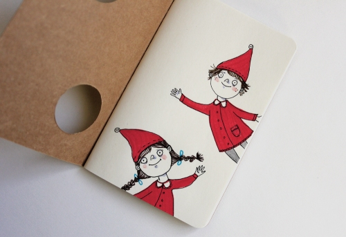 Moleskine journal peeking elves
