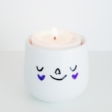 Porcelain candle holder with happy face