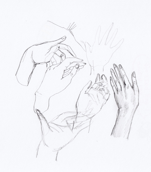 Pencil drawings of hands in sketchbooks showing movement